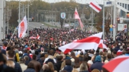 Opposition protesters march in Minsk on October 25.