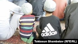 Kyrgyzstan -- Children in mosque, Chaek village, Naryn region, undaed