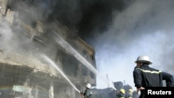 Firefighters battle a blaze after a bomb attack in Kirkuk.
