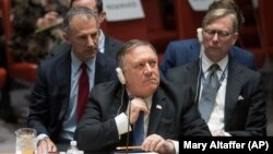 U.S. -- U.S. Secretary of State Mike Pompeo adjusts his tie during a Security Council meeting on Iran's compliance with the 2015 nuclear agreement, at United Nations headquarters in New York, December 12, 2018