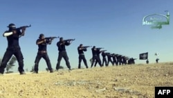 Syria -- An image grab taken from a propaganda video uploaded on September 7, 2013 by Syria's Islamist Ahrar al-Sham group shows its members taking part in a training session at an undisclosed location in Syria