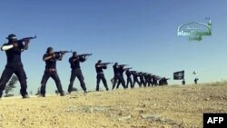 An image taken from a propaganda video uploaded to the Internet last year by Syria's Islamist Ahrar al-Sham group, showing its members taking part in a training session at an undisclosed location in Syria. Ahrar al-Sham has since merged with other Islamist factions to form the Islamic Front.