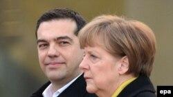 Греческий премьер Алексис Ципрас на встрече с канцлером Германии Ангелой Меркель