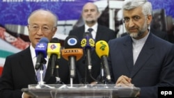Iran -- Irans chief nuclear negotiator Saied Jalil and International Atomic Energy Agency (IAEA) chief Yukiya Amano (L) address a joint press conference, in Tehran, 21May2012