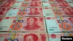 China -- Chinese 100 yuan banknotes are seen in this file picture illustration taken in Beijing May 7, 2013.
