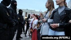Women join protests in central Minsk on September 1.