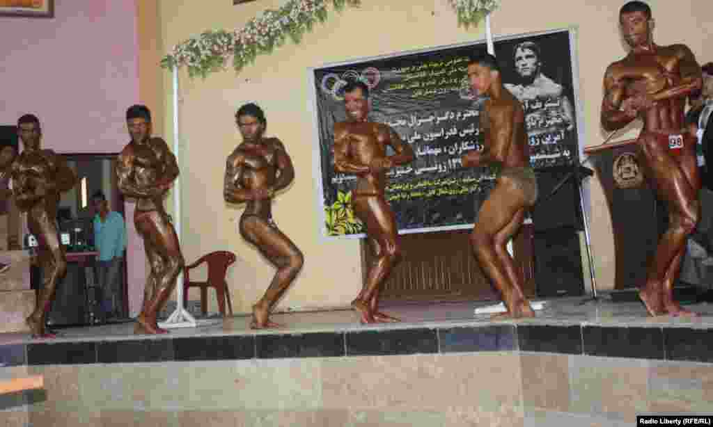 Afghanistan -- Men strike a pose during a National bodybuilding competition in Kabul on 15march 2013