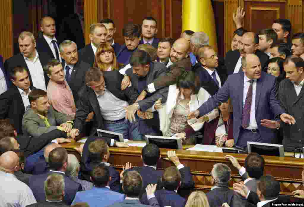 Members of parliament scuffle in Kyiv after a hearing on a draft law concerning Ukraine's territorial sovereignty over the Donetsk and Luhansk regions. (epa-EFE/Stepan Franko)