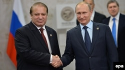 Pakistani Prime Minister Nawaz Sharif (left) shakes hands with Russian President Vladimir Putin during their meeting at the SCO summit in Ufa on July 10.