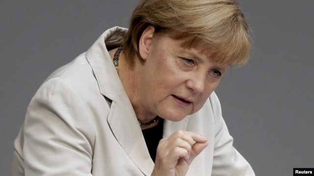German Chancellor Angela Merkel addresses a session of the Bundestag at the Reichstag in Berlin on September 12.
