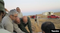 Photos released by Iranian Tasnim News agency shows Iran's Chief of Staff for the Armed Forces, Major General Mohammad Bagheri, among Iranian forces in Syria's Aleppo, undated.