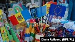 Moldova - flags of Moldova (tricolor) and EU, school supplies, 29Aug2011