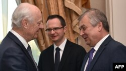 UN special envoy for Syria Staffan de Mistura (left) greets Russian mediator Aleksandr Lavrentyev as they attend the fourth round of Syria peace talks in Astana on May 3.