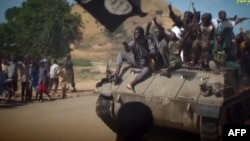 Скриншот видео, в котором сняты предполагаемые боевики группировки «Боко Харам». Иллюстративное фото.