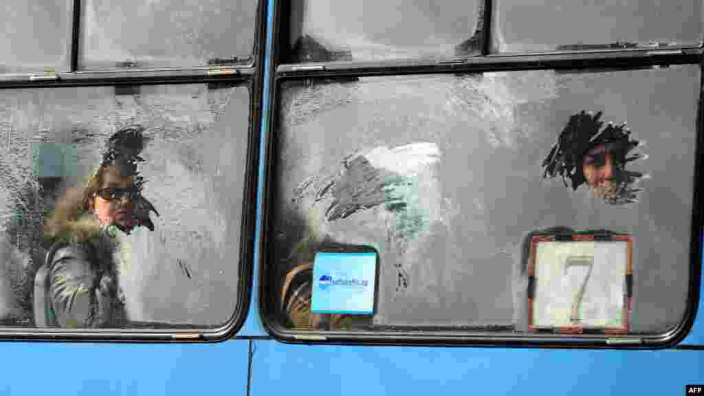 Commuters are seen through an icy window on a tram in central Sofia, Bulgaria.