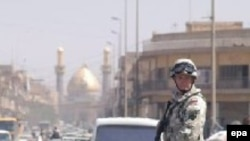 Polish troops, like this one patrolling Karbala in 2003, is the only country other than the U.S. or Britain to have had a full division in Iraq.