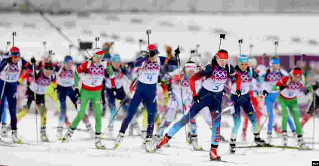 Athletes in action during the women's 12.5-kilometer mass-start competition at the Laura Cross Biathlon Center. (epa/Armando Babani)