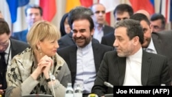 Abbas Araghchi (R), political deputy at the Ministry of Foreign Affairs of Iran, and the Secretary General of the European Union External Action Service (EEAS) Helga Schmid talk as they meet for E3/EU+3 and Iran talks in Vienna. 2018, File photo