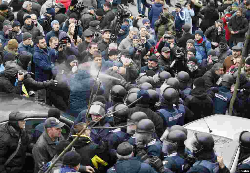 Tear gas or pepper spray being used against protesters during the standoff.