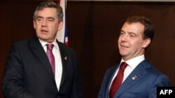 Gordon Brown (left) and Dmitry Medvedev at the G8 summit in Tokyo in July
