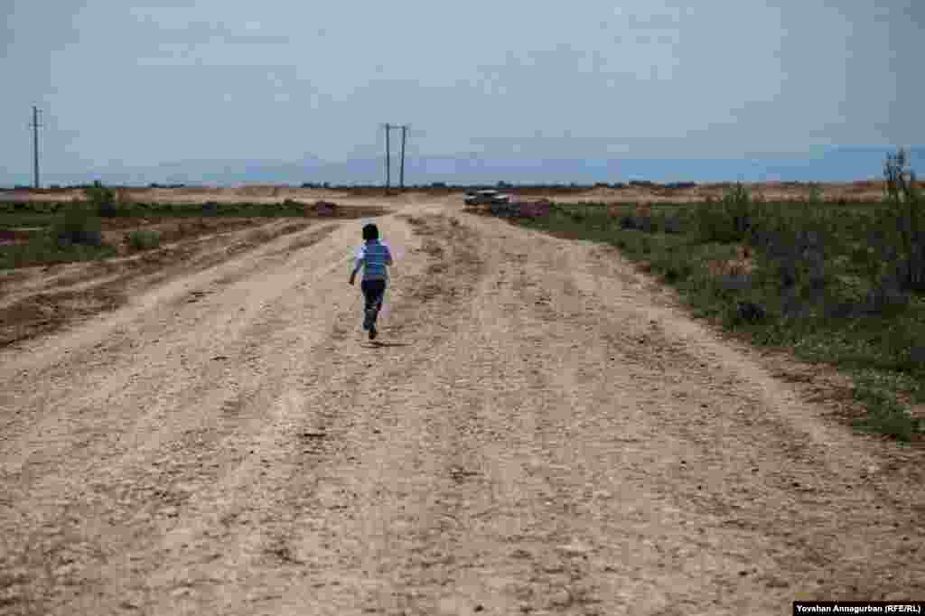 """Children, with no easy form of transportation, often sprint the distance between villages. Annagurban said his son, seeing this boy, said, """"Dad, Turkmenistan has a long way to go!"""""""