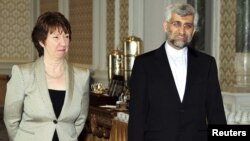 "Catherine Ashton (left) and Said Jalili arrive for talks in Istanbul, which she later described as ""disappointing."""