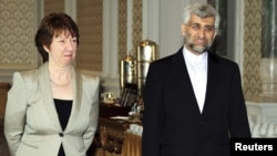Iranian chief nuclear negotiator Said Jalili (right) and EU foreign-policy chief Catherine Ashton arrive for nuclear talks in Istanbul.