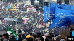 Protesters wave EU flags during a pro-European rally on Independence Square in Kyiv on December 8.