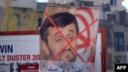 پوستر «جبهة العمل الاسلامى- هيئة الطوارى» علیه سفر محمود احمدی نژاد به لبنان در بندر تریپولی