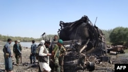 The site of a NATO air strike that destroyed two fuel tankers hijacked by the Taliban in northern Konduz Province