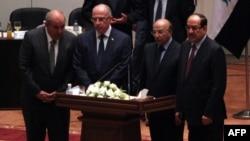 Мурдагы премьер Нури ал-Малики (оңдо) үч вице-президенттин бири болду.