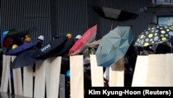Гонконгдогу нааразылык акцияларынын катышуучулары. 29-июль, 2019-жыл.