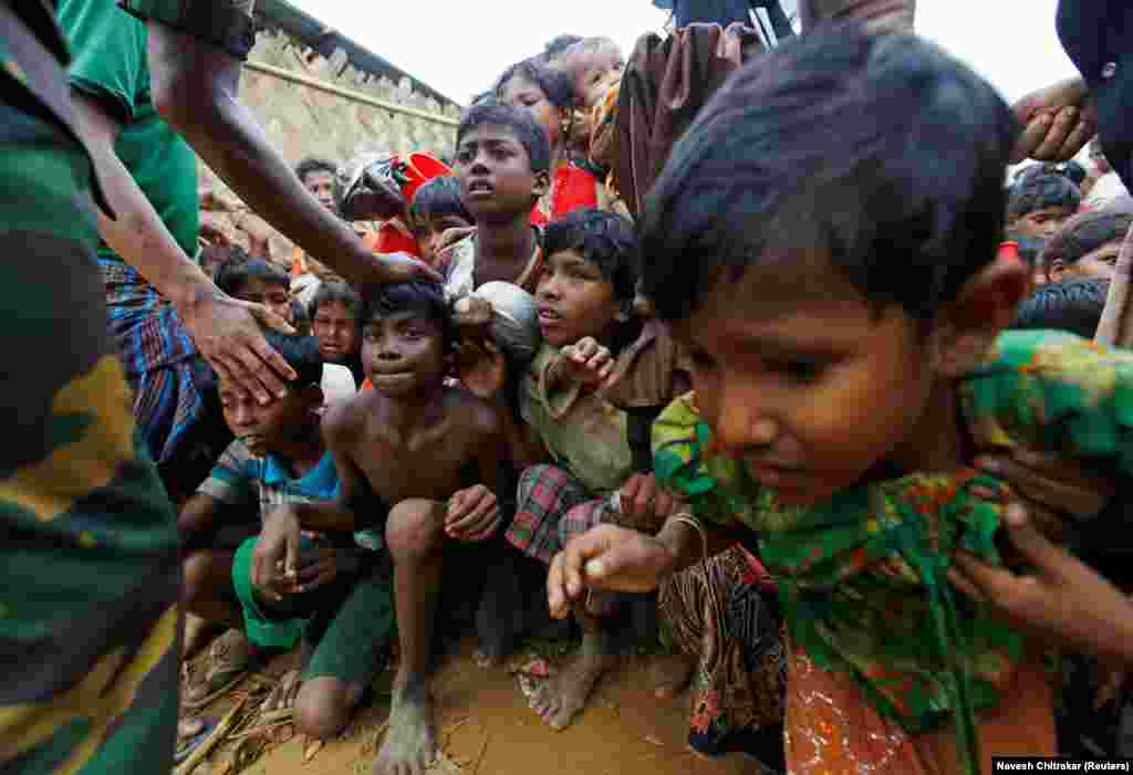 Rohingya refugee children struggle as they wait to receive food outside a distribution center at the Palong Khali refugee camp near Cox's Bazar, Bangladesh. (Reuters/Navesh Chitrakar)