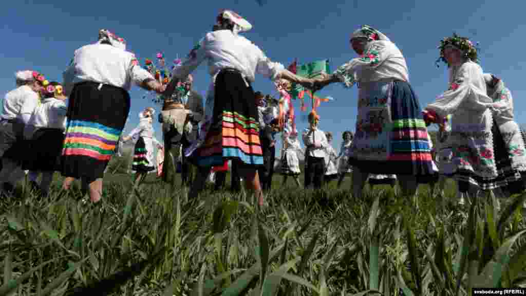 Members of the Mizhrechcha folk ensemble perform a circle dance in a field in the village of Pahost.