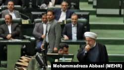Iranian President Hassan Rouhani appeared before parliament on Aug. 28 to defend his government's handling of Iran's economic crisis.