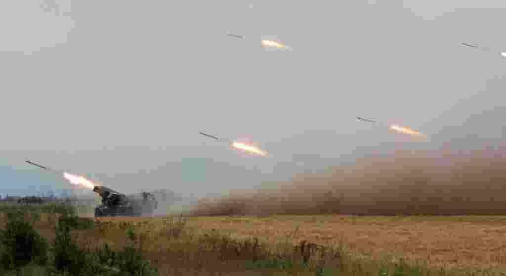 "Georgian forces fire rockets at separatist South Ossetian troops close to the region's capital, Tskhinvali, on August 8. Georgian officials said the country was taking measures to prevent Russian ""mercenaries"" from infiltrating the country."