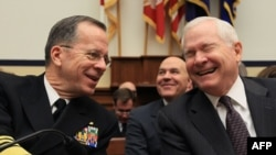 U.S. Defense Secretary Robert Gates (right) and Admiral Mike Mullen share a laugh during a House Armed Services Committee hearing in Washington on February 16.