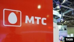 The logo of MTS, Russia's largest mobile operator, is seen at a telecoms exhibition in Moscow.