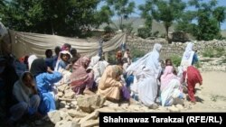 Students of a girls primary school hold class on the rubble of their school in June after it was destroyed by the Pakistani Taliban in Bajaur Agency.