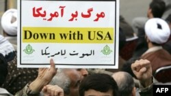 A member of the Basij militia holds an anti-U.S. slogan during a rally outside the former U.S. Embassy in Tehran in November.