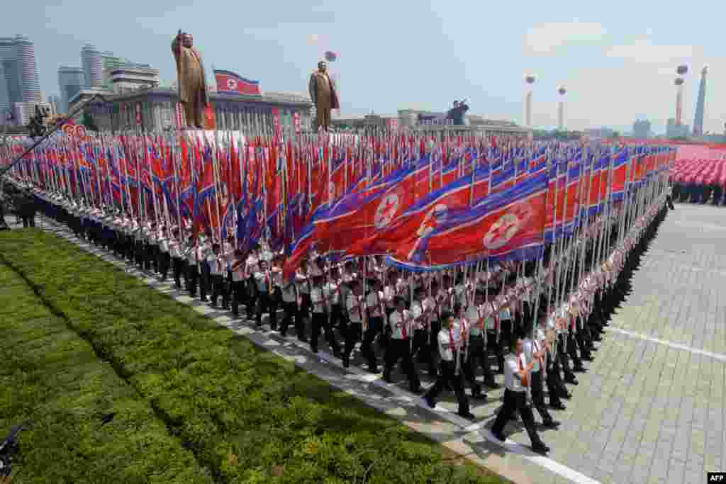 A parade in Kim Il Sung Square in the North Korean capital, Pyongyang, marked the 60th anniversary of the Korean war armistice. (AFP/Ed Jones)