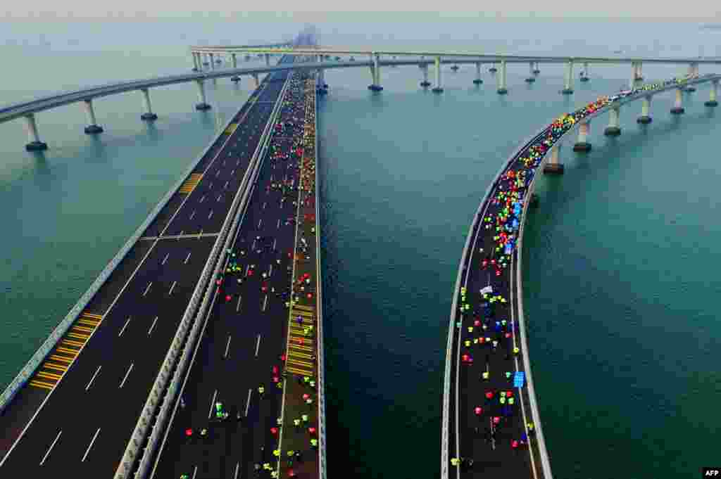 Participants cross the Jiaozhou Bay Bridge as they compete in the 2017 Qingdao International Marathon on the Sea in Qingdao in China's eastern Shandong Province. (AFP/Stringer)