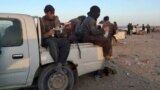 Afghans being smuggled in pickup trucks from Zaranj in Nimroz Province to the Pakistani border in March 2021.