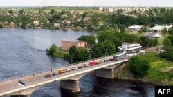 The bridge over the Narva River separates the Estonian city of Narva from Ivangorod in Russia.