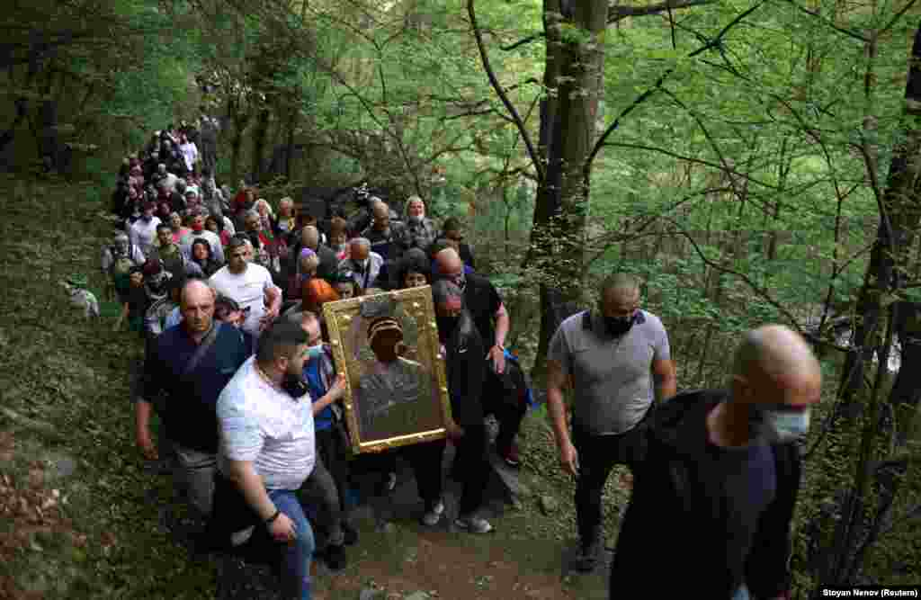 Orthodox Christians carry an icon of the Virgin Mary during a procession marking Easter near the  Bachkovo Monastery in Bulgaria on May 3.