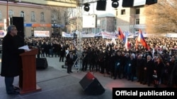 Armenian President Serzh Sarkisian (left) addresses an election campaign rally in Ararat on February 4. The election is widely seen as Sarkisian's to lose.