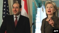 Iraqi Prime Minister Nuri Al-Maliki and U.S. Secretary of State Hillary Clinton opened the investment conference