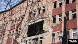 A view of the hole in the hospital facade after the blast in Luhansk.