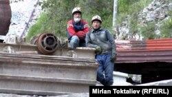 Кыргызстандык жумушчулар.