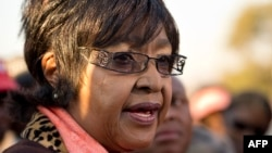 Winnie Madikizela-Mandela. Nelson Mandela's ex-wife, speaks to the media outside their first family home in Soweto on June 28.